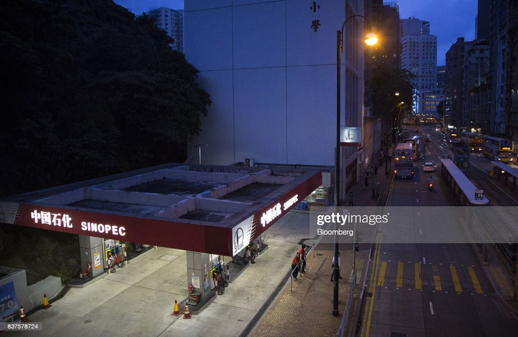 A China Petroleum & Chemical Corp. (Sinopec) gas station stands at dusk in Hong Kong, China, on Tuesday, Aug. 22, 2017. Sinopec is scheduled to report second-quarter results on Aug. 25. Photographer: Vivek Prakash/Bloomberg via Getty Images