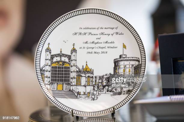 A china plate to commemorate the wedding between Henry Windsor and Meghan Markle stands on display at Halcyon Days Ltd's factory in StokeonTrent UK...