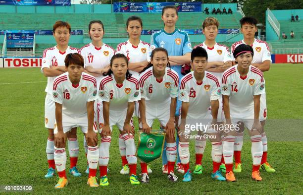 China players pose before the start of the AFC Women's Asian Cup Group B match between Myanmar and China at Thong Nhat Stadium on May 17 2014 in Ho...