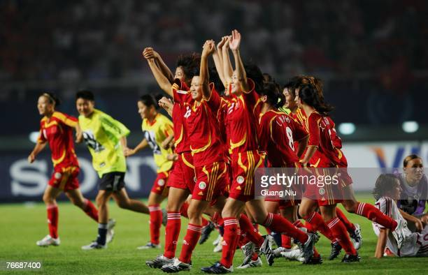 China players run past Denmark's players as they celebrate to win the match by 3-2 against Denmark in the FIFA Women's World Cup 2007 Group D match...