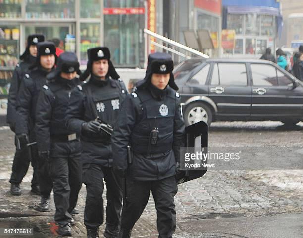 URUMQI China Police officers patrol the streets of China's Urumqi the capital of China's Xinjiang Uyghur Autonomous Region on Feb 27 after bloggers...