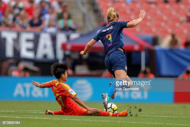 China PR midfielder Ren Guixin with a sliding tackle on U.S. Women's National Team midfielder Samantha Mewis during the first half of the...