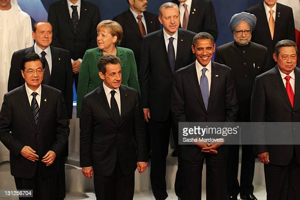 China Prime Minister Hu Jintao French President Nikolas Sarkozy and USPresident Barack Obama attend a group photo session at the G20 Summit on...