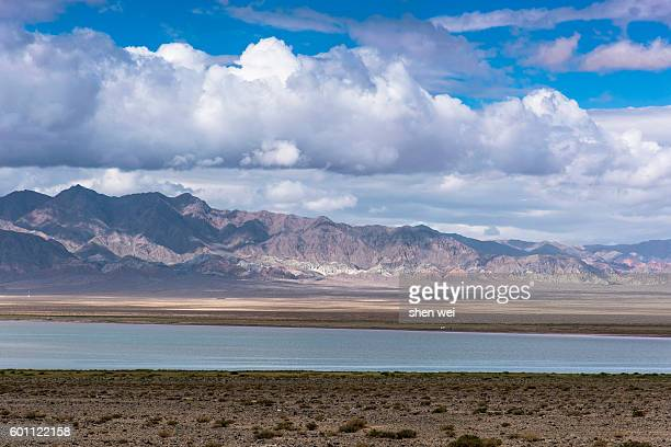 china, qinghai province, golog, landscape with nianboyuze mountains and lake - qinghai province stock photos and pictures