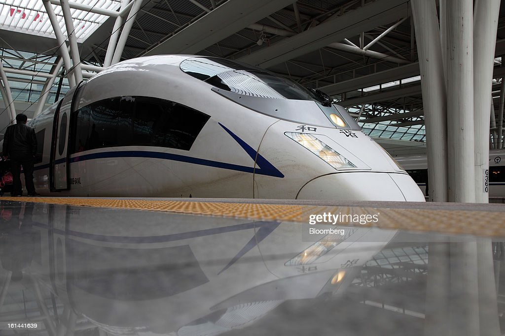 A China Railways high speed trains is parked at Hongqiao Railway Station in Shanghai, China, on Friday, Feb. 8, 2013. A record 3.41 billion passenger trips may be made this year during the Lunar New Year period, according to the National Development and Reform Commission. Photographer: Tomohiro Ohsumi/Bloomberg via Getty Images