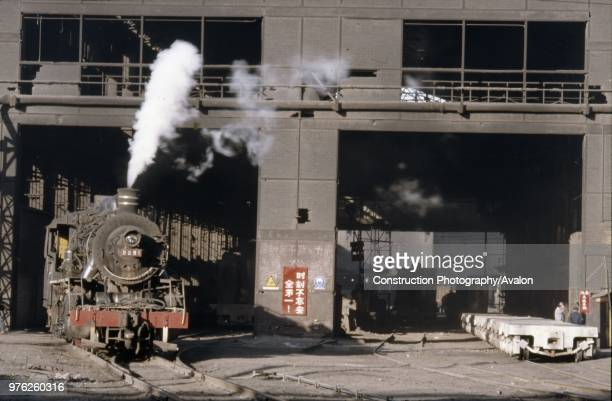 A China Railways JF6 at Anshan Iron Steel Works These Japanese light Mikados were developed from an American built ALCO design which was exported to...