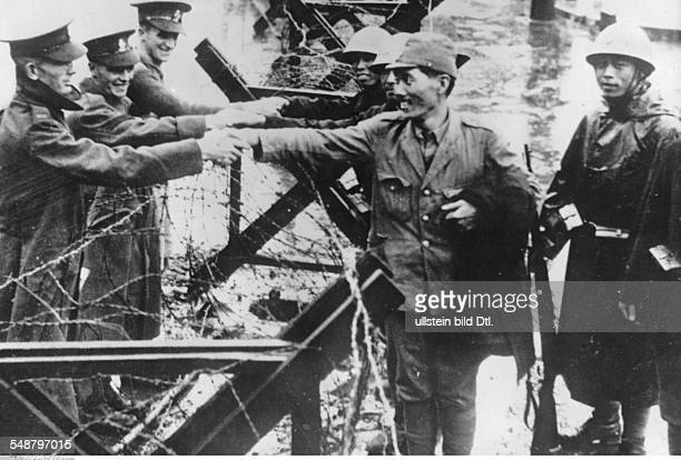 China Second SinoJapanese War 19371945 After the end of the Battle of Shanghai Japanese soldiers in the embattled district of Zhabei shaking hands...