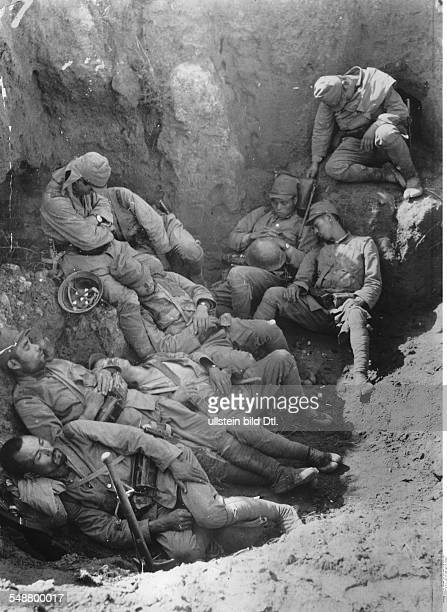 China Second SinoJapanese War 19371945 Battle of Tientsin exhausted Japanese soldiers sleep in a bomb crater near Manchang during a pause in the...