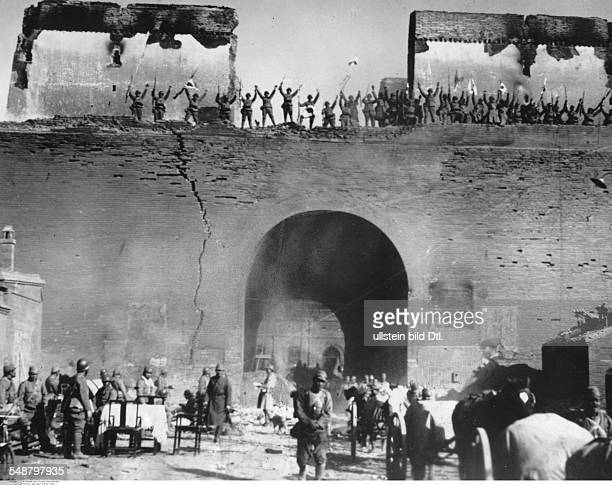China Second SinoJapanese War 19371945 Japanese advance in Shanxi Japanese troops celebrate their victory on the city walls of Taiyuan after the...