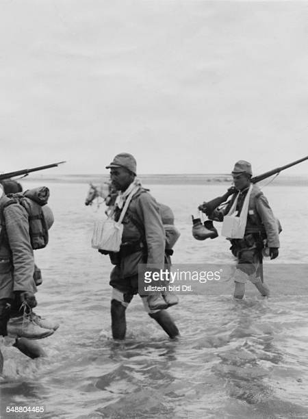 China Second SinoJapanese War 19371945 Japanese soldiers wade through water Around their neck are urns containing the ashes of fallen comrades which...