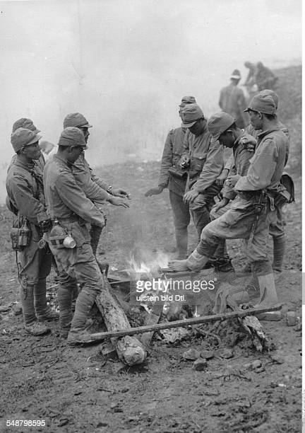 China Second SinoJapanese War 19371945 Japanese soldiers warming themselves at a fire in the North Chinese theater midOctober 1937 Vintage property...