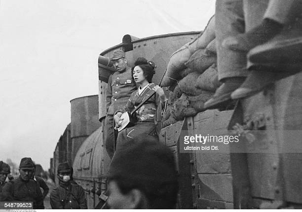 China Second SinoJapanese War 19371945 Japanese troop entertainment a geisha on a tank train is singing for the soldiers 1938 Vintage property of...