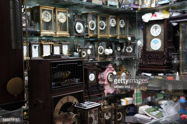 A rag shop with clocks in the old town