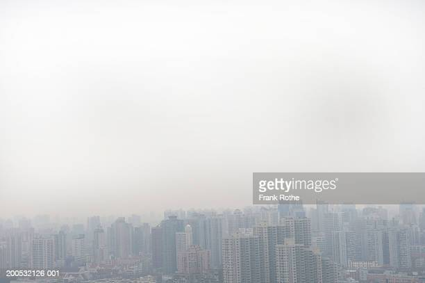 China, Shanghai, cityscape covered in fog