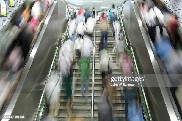 China, Shanghai, commuters on escalator at underground railway station