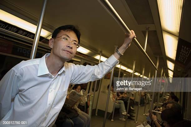 China, Shanghai, mature man on subway train
