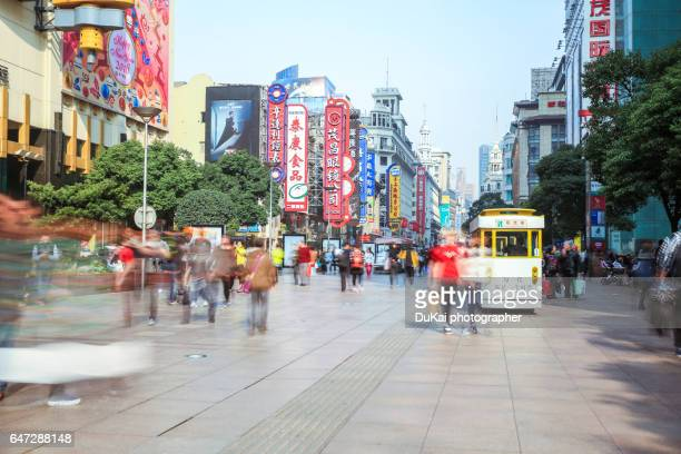 China, Shanghai, pedestrians on Nanjing Road,