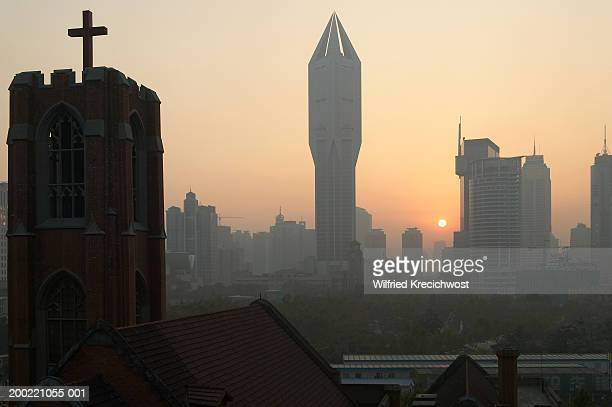 China, Shanghai, People's Square, high-rise buildings on skyline, dawn