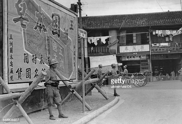 China Shanghai Second SinoJapanese War 19371945 Japanese soldiers controlling Shanghai after the end of the fightings in the city November 1937...