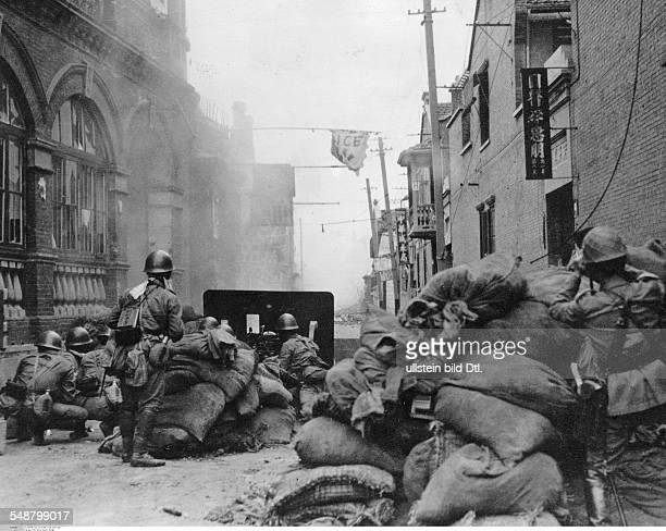 China Shanghai Second SinoJapanese War 19371945 Japanese troops on the attack in the streets of Zhabei a workers area of Shanghai 1937 Vintage...