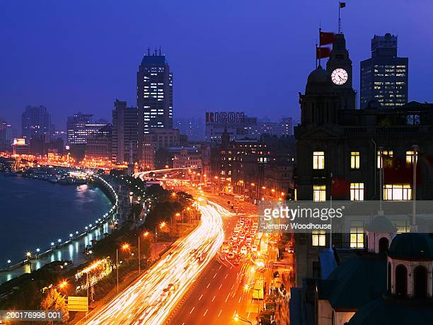 China, Shanghai, The Bund at dusk, elevated view (blurred motion)