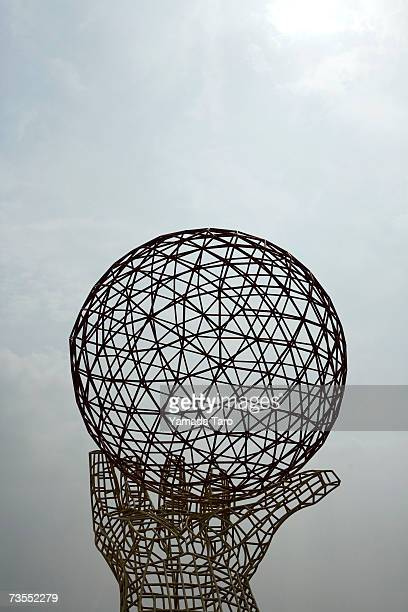 China, Shanghai, wireframe hand and globe sculpture
