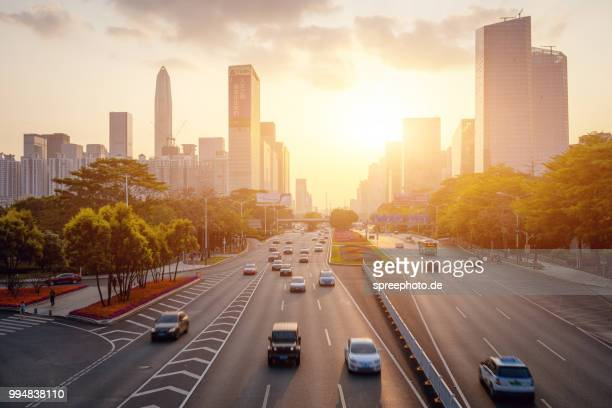 china, shenzhen skyline panorama with traffic - verkehrswesen stock-fotos und bilder