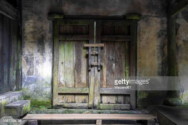 China, Sichuan Province, Wulong, closed wooden portal