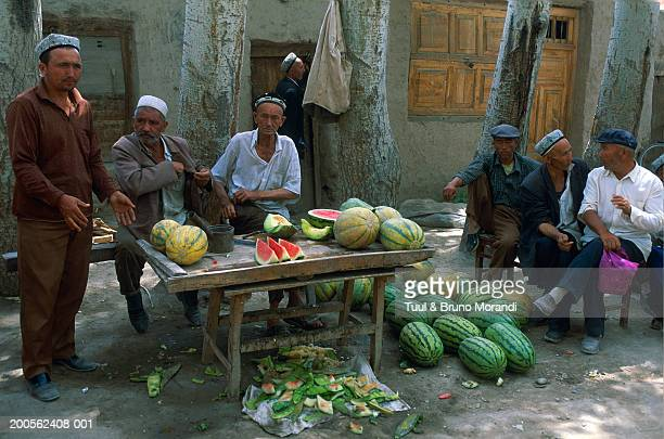 China, Sinkiang Province, Kashgar, market, men selling watermelons