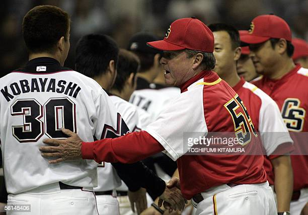 China Stars team manager James Lafebvre congraturates Japan's Chiba Lotte Marines closer Masahide Kobayashi after their Asia Series 2005 game in...