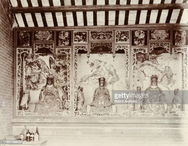 China Statues of Chinese deities line the walls inside a Joss house Original manuscript caption Interior of Joss House Santan Island near Hong Kong...