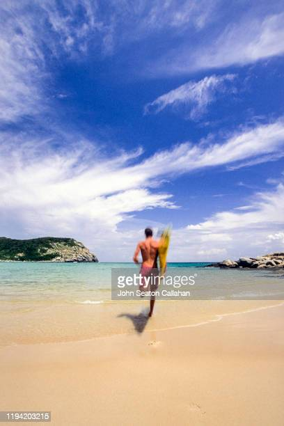 china, surfer on hainan island - haikou stock pictures, royalty-free photos & images