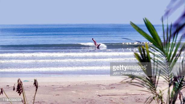 china, surfing on hainan island - haikou stock pictures, royalty-free photos & images