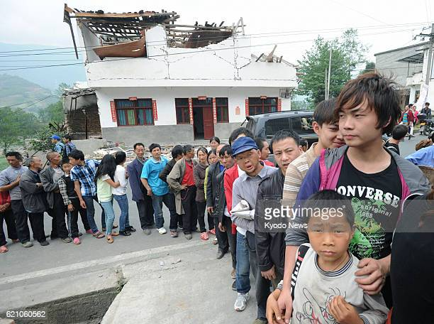 YA'AN China Survivors line up for food supplies in the Lushan county area of Ya'an in the southwestern Chinese province of Sichuan on April 22...