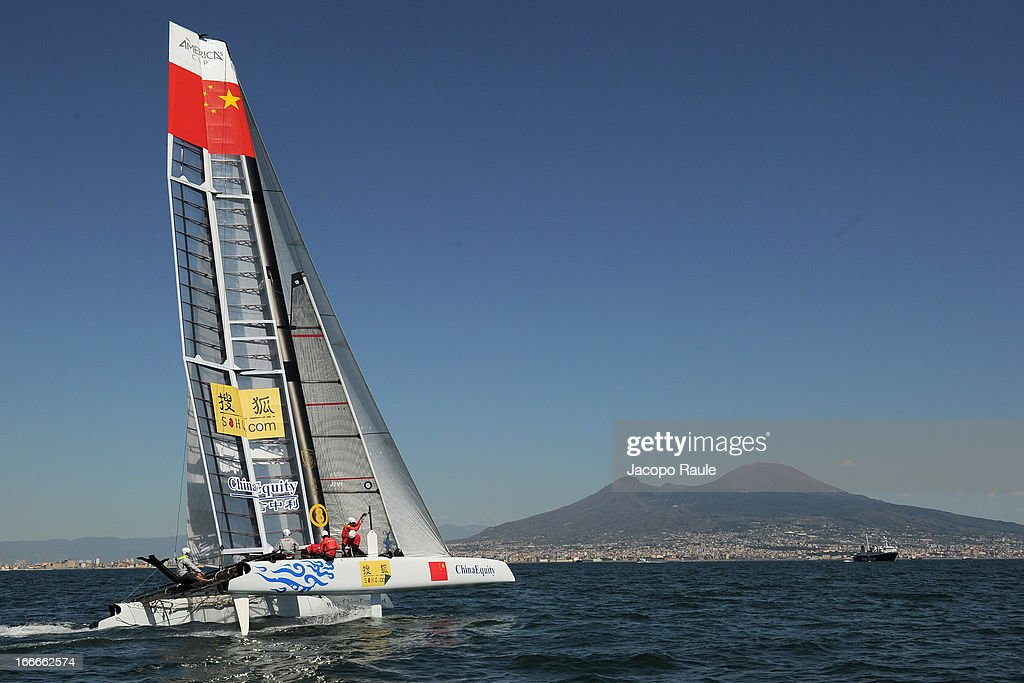 China Team skippered by Mitch Booth sails during a training session in front of Vesuvius ahead of the AC World Series Naples on April 15, 2013 in Naples, Italy.