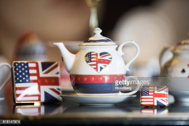 A china teapot centre and enamel trinket cases made to commemorate the wedding between Henry Windsor and Meghan Markle stand on display at Halcyon...