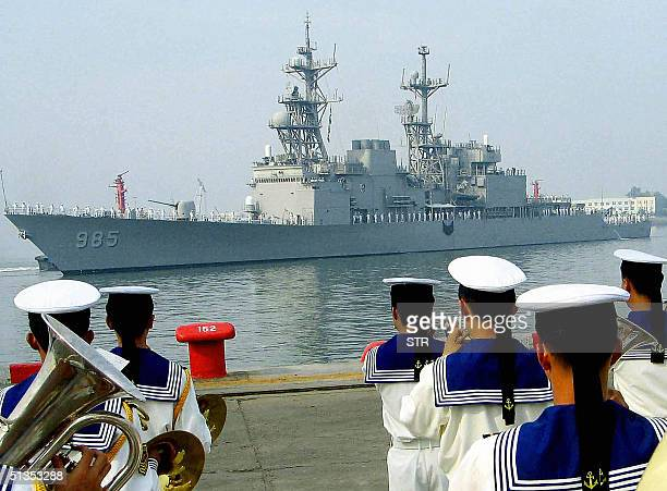 The Chinese People's Liberation Army Navy band play as the US ship the USS Cushing a Spruanceclass destroyer berths at naval base in the eastern...