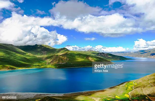 China, Tibet, Hima Alaya, River with green mountains on shore