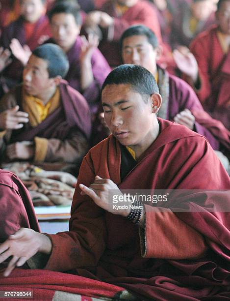 YUSHU China Tibetan monks chant Buddhist invocations in Yushu Qinghai Province on April 13 during a ceremony to commemorate the victims of the major...