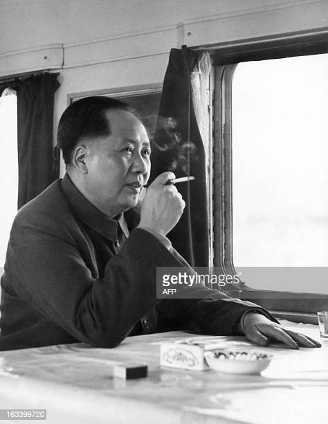 China top communist leader Chairman of Communist Party and President of the Republic Mao Zedong enjoys a cigarette as he travels in 1961 in his train...
