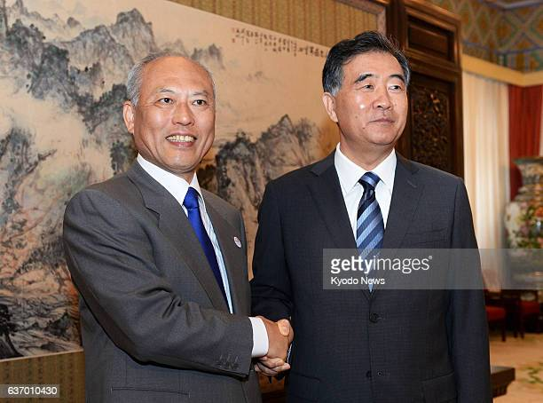 BEIJING China Visiting Tokyo Gov Yoichi Masuzoe and Chinese Vice Premier Wang Yang shake hands in Beijing on April 26 prior to their talks After the...