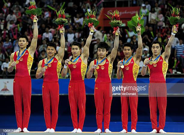 China win gold in the Men's Team Artistic Gymnastics at the Asian Games Town Gymnasium during day one of the 16th Asian Games Guangzhou 2010 on...