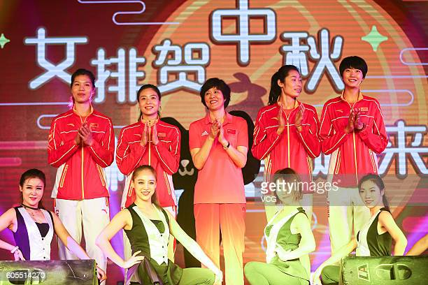 China Women's Volleyball players Xu Yunli Wei Qiuyue head coach Lang Ping players Zhu Ting and Yuan Xinyue pose on stage during their visit Alibaba...
