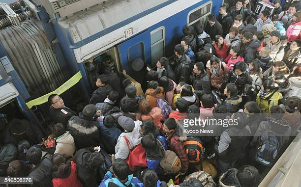 BEIJING China Workers and students swarm a platform at Beijing West station on Jan 18 2011 An estimated 285 billion people will have likely used...