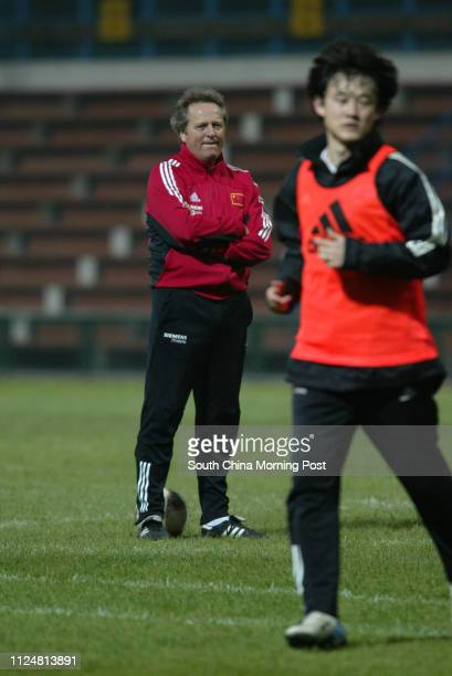 China World Cup soccer team coach Arie Haan watches Sun Jihai training at Mong Kok Stadium 29 March 2004