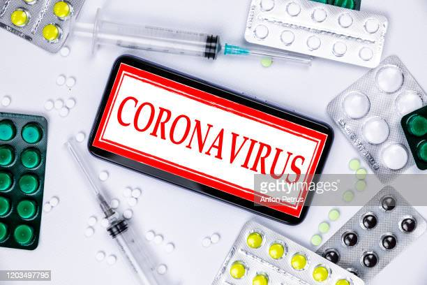 china, wuhan. smartphone with aliepress logo with pills and vaccine. novel coronavirus 2019-ncov. - coronavirus stock pictures, royalty-free photos & images