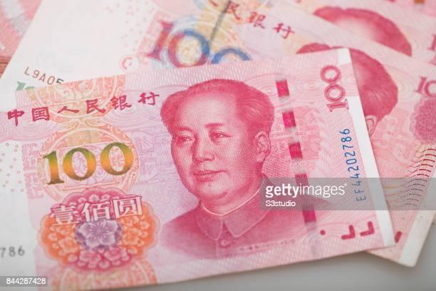 China Yuan of Mao dollar bank note are arranged for a photograph on 07 September 2017 in Hong Kong Hong Kong