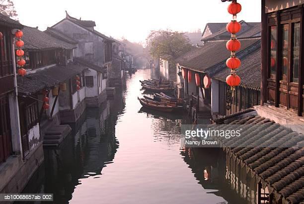 China, Zhou Zhuang, housing with lanterns on canal