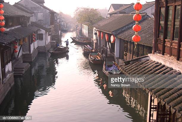 China, Zhou Zhuang, person in boat on canal