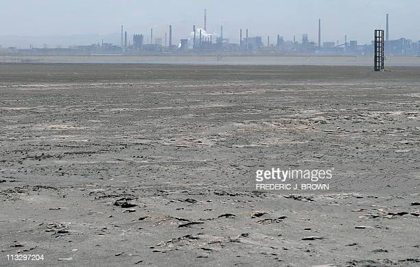 Chinacommoditiesminingenvironment by Allison JacksonA vast expanse of toxic waste fills the tailings dam on April 21 frequently whipped up by strong...
